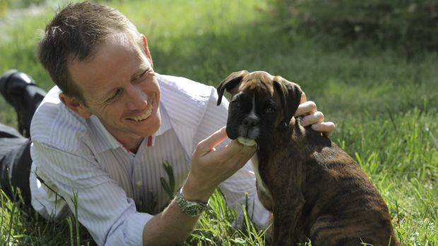 Tough new laws: Greens Minister Shane Rattenbury, with Boxer Wesley.