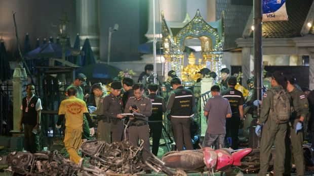 Police investigate the scene at the Erawan Shrine after the explosion in Bangkok in August.