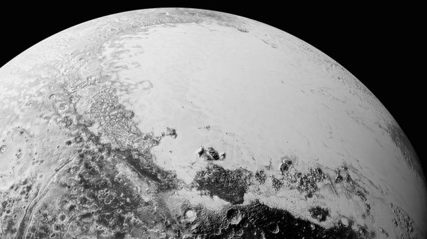 This July 14, 2015, photo provided by NASA shows a synthetic perspective view of Pluto, based on the latest ...