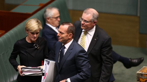 Prime Minister Tony Abbott departs question time with Julie Bishop and Scott Morrison while Malcolm Turnbull remains on ...