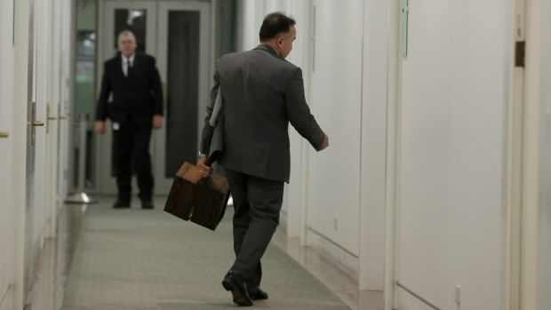 Deputy government whip Andrew Nikolic arrives to the partyroom with the ballot boxes.