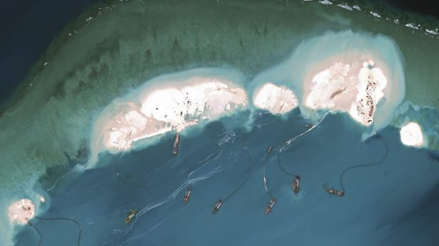 Chinese dredges working in March at the northernmost reclamation site of Mischief Reef, part of the Spratly Islands, in ...