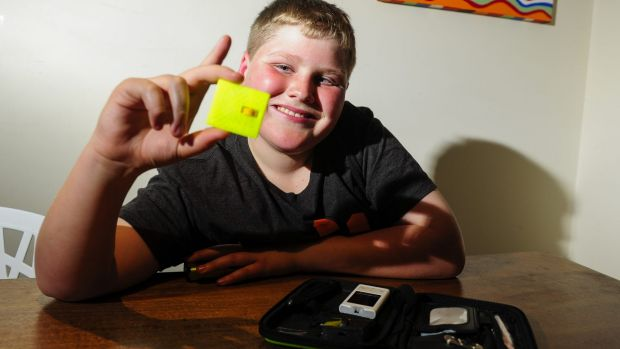 St Edmund's College year 5 student William Grame, 11, has designed a test strip remover unit that fits into a ...