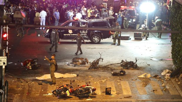 A policeman photographs debris after the August 17, 2015, explosion in central Bangkok.