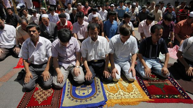 Uighur men pray in a mosque in Urumqi, the capital of western China's Xinjiang province.