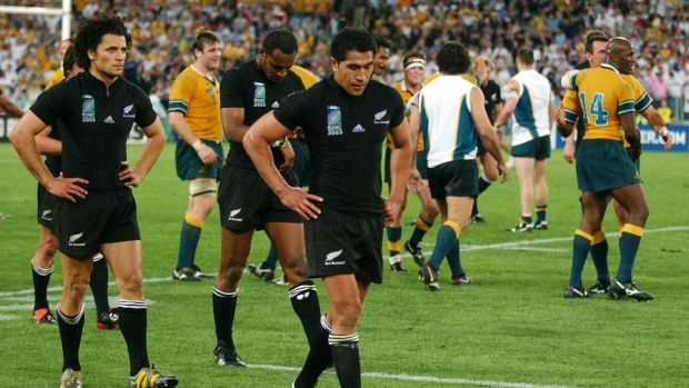 Semi-final anguish: New Zealand players leave the field as the Wallabies celebrate after the final whistle during the ...