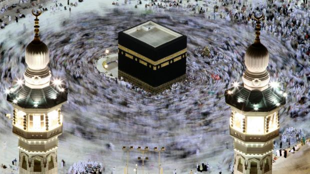 Tens of thousands of Muslim pilgrims move around the Kaaba inside the Grand Mosque during the annual Hajj in Mecca, ...