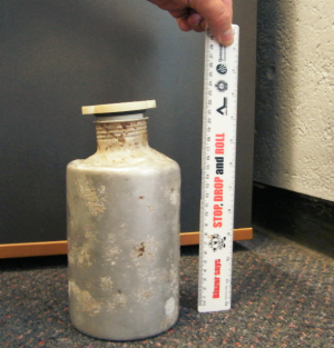 A canister of aluminium phosphate that washed up on Forrest Beach in Queensland.
