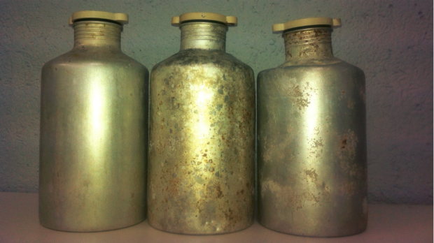 Three canisters containing aluminium phosphate that are belived to have fallen off, or were dumped, by a shipping vessel ...