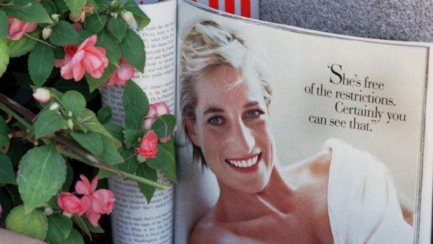 A past issue of <i>Vanity Fair</i> magazine lies open to a photograph of Princess Diana at a memorial in San Francisco ...