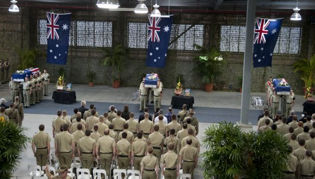 The coffins of Australian soldiers Lance Corporal Rick Milosevic, Sapper James Martin and Private Robert Poate at a ...