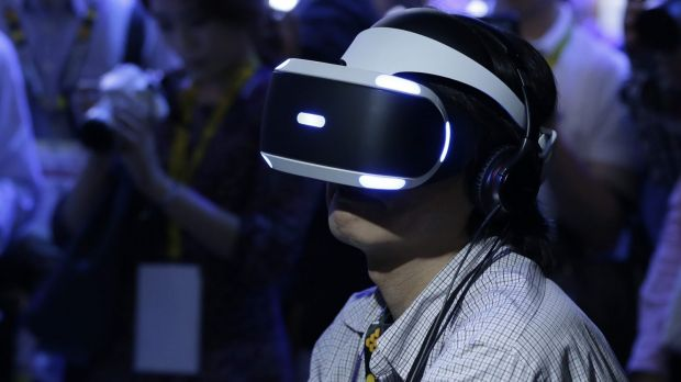 A Tokyo Game Show attendee tries out the PlayStation VR headset.