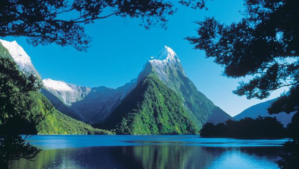 New Zealand's economy grew by faster than expected in the third quarter, thanks to booming tourism.
