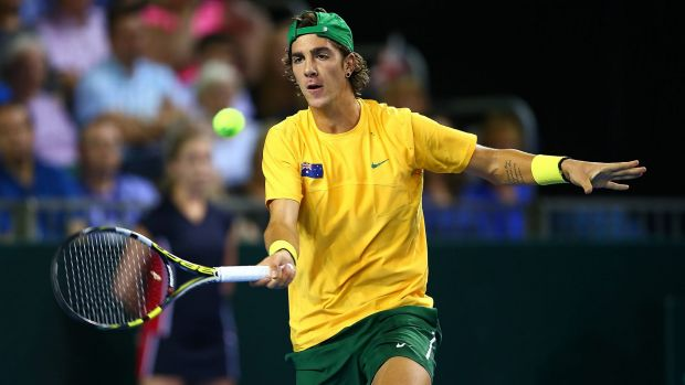 Thanasi Kokkinakis hits a forehand return.