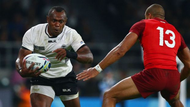 Fijian flyer: Waisea Nayacalevu of Fiji on the attack against England.