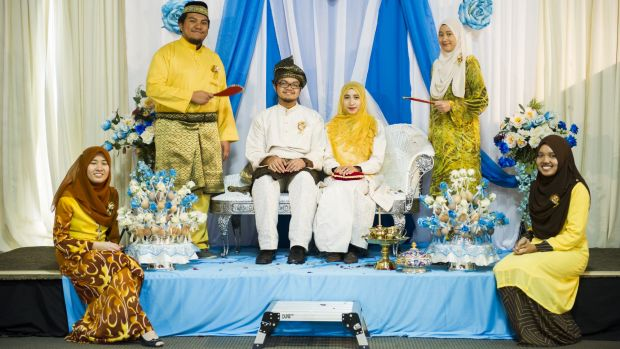 A traditional wedding takes place at the Malaysian High Commission in Yarralumla.