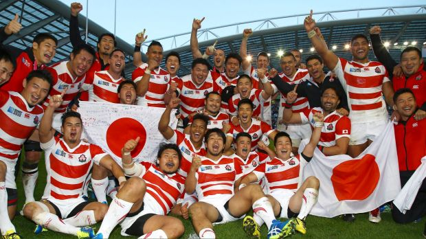Cherry Blossoms in bloom: Japan players celebrate after defeating South Africa.