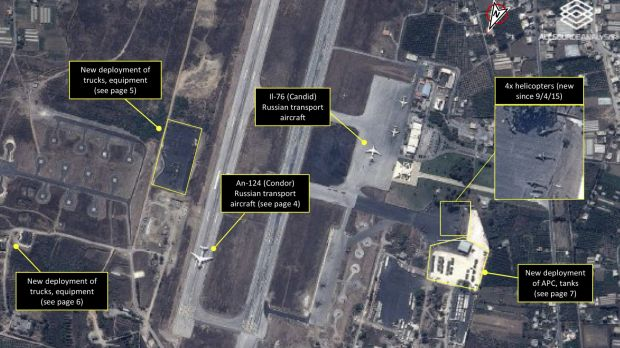 A satellite image shows Russian transport aircraft, helicopters, tanks, trucks and armed personnel carriers at an air ...