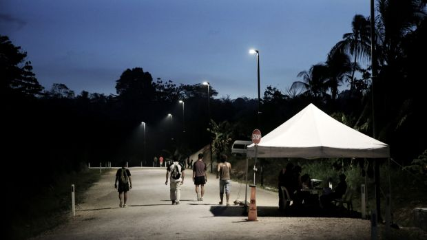 Refugees pass the security checkpoint as they return to the East Lorengau Transit Centre on Manus Island.