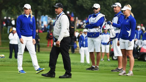 Suzanne Pettersen;  and Charley Hull of team Europe explain to LPGA referee Dan Maselli that Alison Lee's putt was not ...