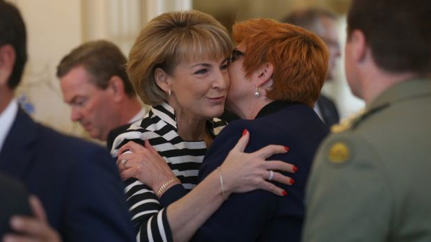 Senator Marise Payne is embraced by Senator Michaelia Cash before the ministry swearing in ceremony at Government House ...