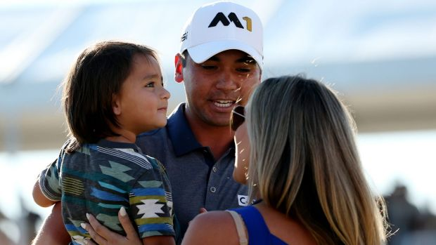 From humble beginnings, Jason Day, pictured with son Dash and wife Ellie, is in a rich vein of form
