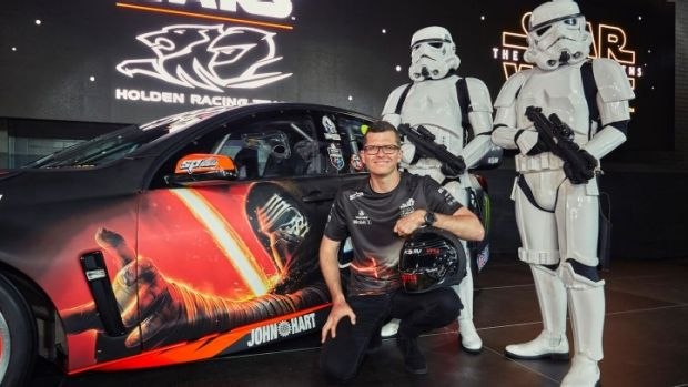 Well guarded: Garth Tander and a couple of stormtroopers at the launch of his new car on Monday.