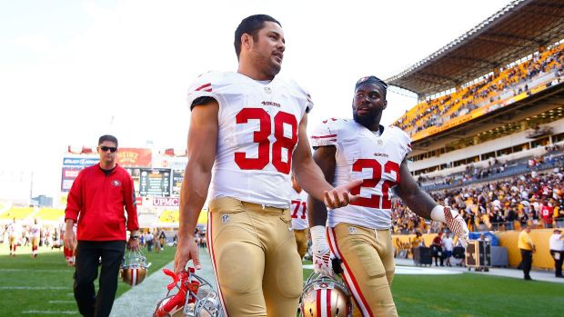 Fitting in: Hayne and Mike Davis leave the field after the 49ers loss to the Steelers.