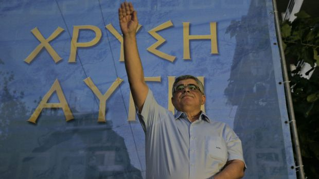 Nikos Michaloliakos, leader of Golden Dawn, salutes his supporters during a pre-election rally in Athens last week.