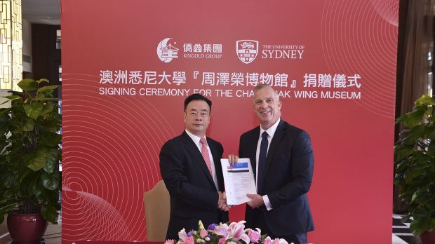 Dr Chau Chak Wing and vice-chancellor of the University of Sydney Dr Michael Spence in Guangdong, China, shaking hands ...