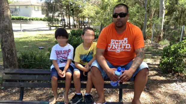 Ricardo Bolvaran, pictured with the two youngest of his three children prior to his imprisonment.