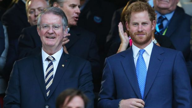Royal affair: Bernard Lapasset and Prince Harry have a chat during last year's Rugby World Cup.