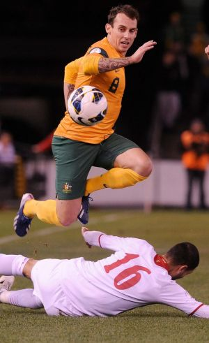 Luke Wilkshire playing for the Socceroos in 2013.