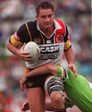 Former Western Reds captain Mark Geyer takes a hit up.