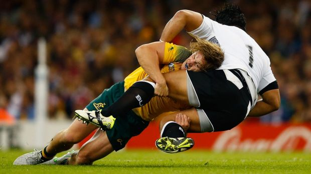 CARDIFF, WALES - SEPTEMBER 23:  Michael Hooper of Australia tackles Campese Ma'afu of Fiji during the 2015 Rugby World ...