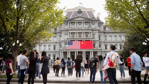 The Chinese flag is displayed next to the American flag on the side of the Old Executive Office Building in the White ...