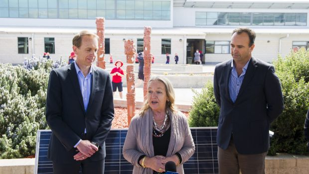 Environment Minister Simon Corbell, Education Minister Joy Burch and Solar Choice managing director Angus Gemmell ...