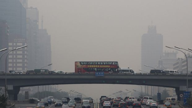 Pollution haze shrouds heavy traffic on the roads of Beijing on Tuesday. The Chinese capital city was hit by thick ...
