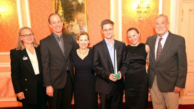 Snowden receiving the Sam Adams Associates for Integrity in Intelligence Award (SAAII) alongside UK WikiLeaks journalist ...