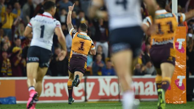 Gift: Darius Boyd races away to score in the opening minute against the Roosters.