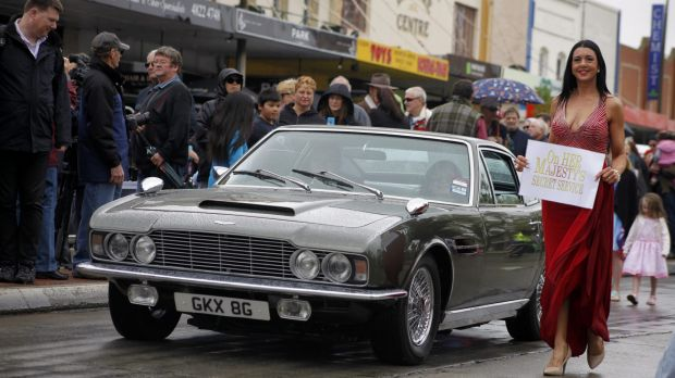Serena Greaves walks alongside the original Aston Martin DBS from On Her Majesty's Secret Service, driven by owner Sigi ...