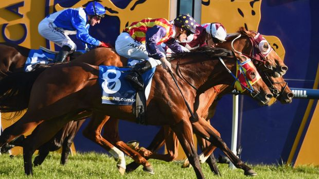 Craig Williams takes Stratum Star (centre) to the front ahead of Damien Oliver on Disposition (right) and Mark Zahra on ...