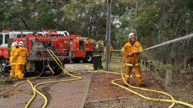 Back with the crew: former prime minister Tony Abbott takes part in an RFS training exercise.