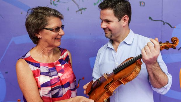 Vicki Olsson with concertmaster Andrew Haveron and the 1757 Guadagnini violin that she has loaned to the Sydney Symphony ...