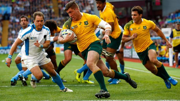 Versatile: Wallabies flanker Sean McMahon scores against Uruguay.