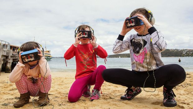 Sprays, Avalon and Anais Pitcher using iChicken virtual reality gear at Manly Wharf.