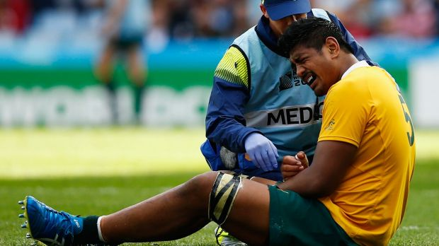 Scratched: Will Skelton feels the pain against Uruguay.