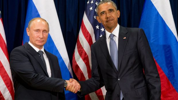 United States President Barack Obama, right, and Russia's President Vladimir Putin pose before a bilateral meeting on Monday.