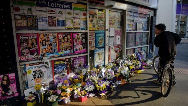 Memorials left outside the Lin family's newsagency after the murders.