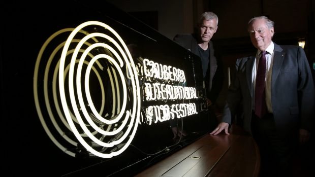 Canberra International Film Festival boardmember Cris Kennedy and general manager Andrew Pike with the neon sign made to ...